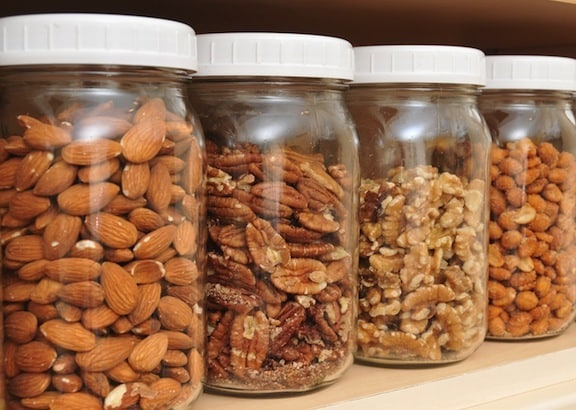 Almonds, pecans, walnuts, and peanuts in jars