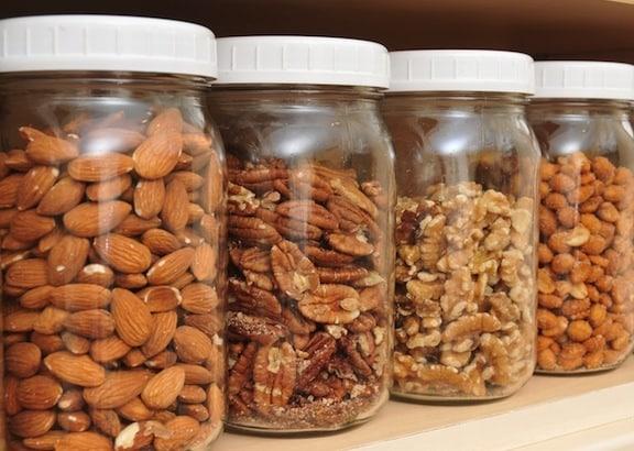 Almonds, pecans, walnuts, and peanuts in jars