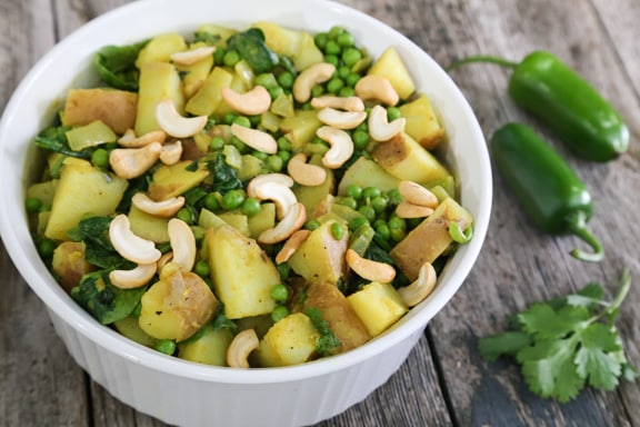 Curried potatoes with peas and cashews recipe