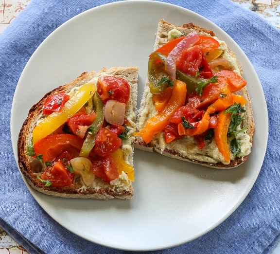 Spanish bell pepper sauté (piperade) on bread