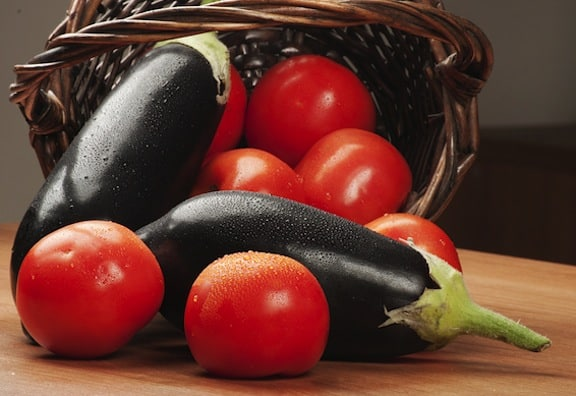 Tomatoes and eggplant in basket