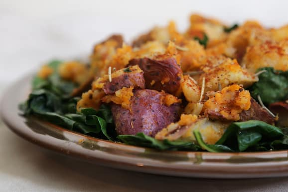 Potatoes with collard greens and vegan sausage