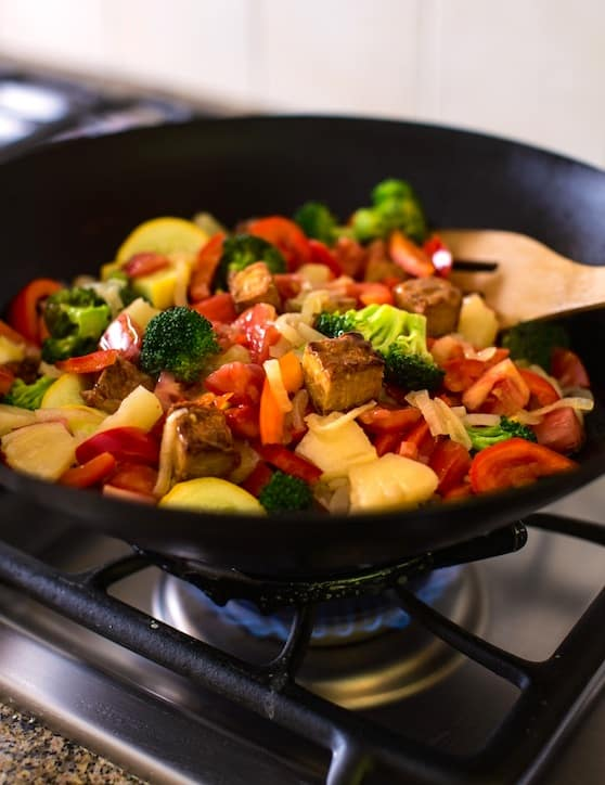 Sweet and sour stir-fried vegetables with tempeh and pineapple