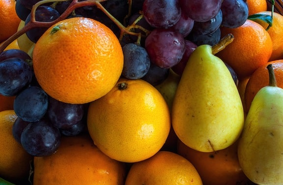 Winter fruits - grapes, oranges, pears