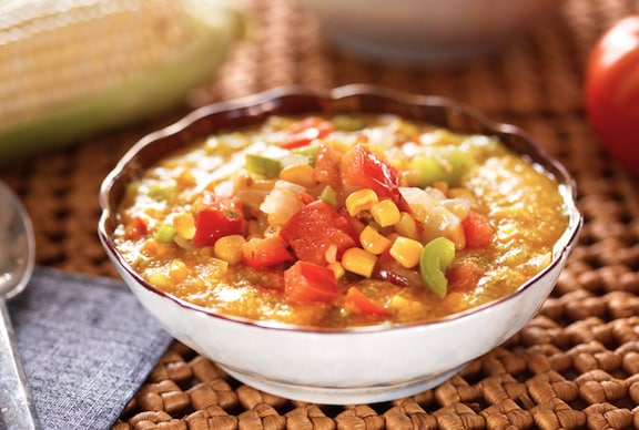 Hominy grits with corn and tomatoes
