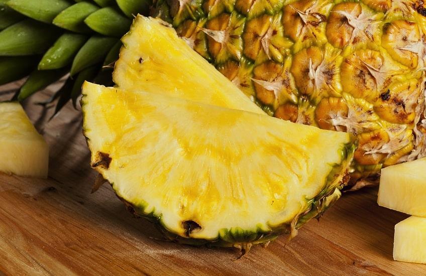 Fresh pineapple on table