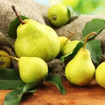 Juicy pears on table