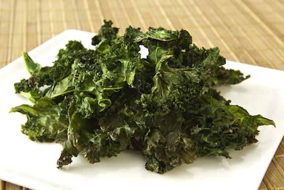 Salt and vinegar kale chips on a plate