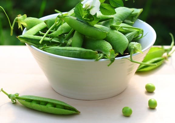 Fresh green peas in a bowl