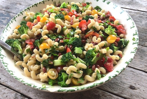 Pasta salad with red beans, tomatoes, and broccoli