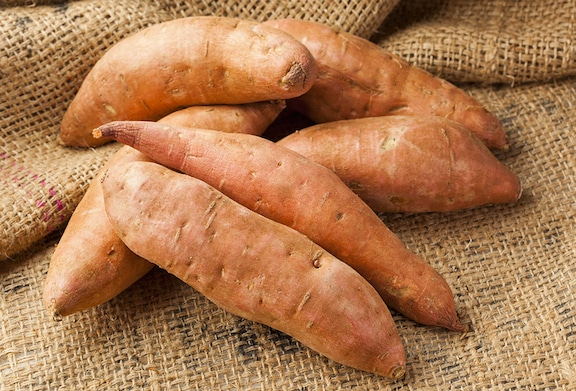 Sweet potatoes on table