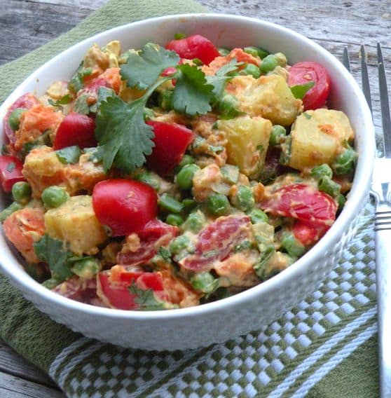 Curried potato tomato salad with green peas