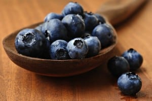 Blueberries on wooden spoon