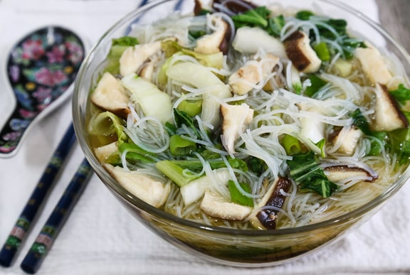 Rice Noodle Soup with Lettuce and Mushrooms