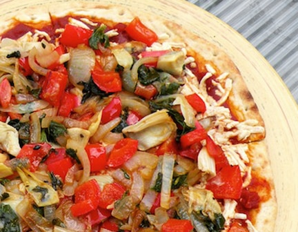 vegan veggie pizza with peppers, onions, and artichokes
