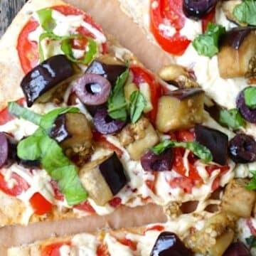 Eggplant, fresh tomato, and olive pizza
