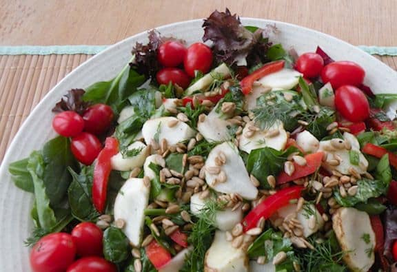 Jerusalem artichoke salad with greens and herbs