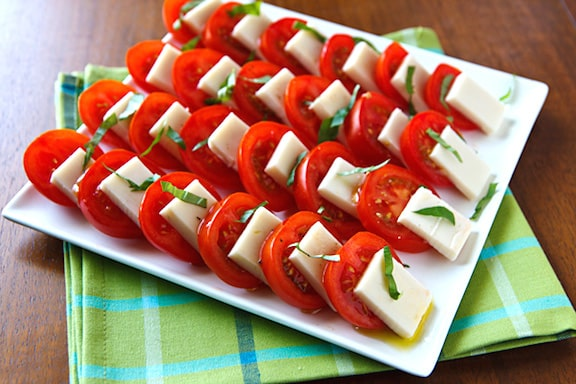 Vegan Caprese Salad (tomatoes, vegan mozzarella, and basil)