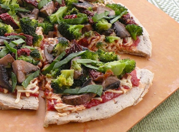 Vegan Broccoli, mushroom, and dried tomato pizza