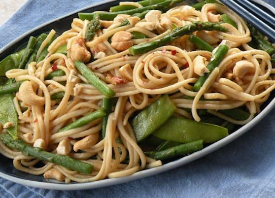 Udon noodles with asparagus and snow peas