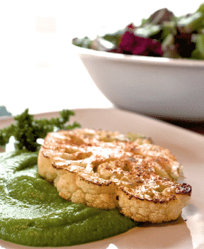 Cauliflower Steaks with green pea puree by helyn dunn