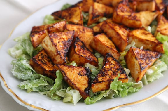 Easy everyday tofu recipes pdf e book vegkitchen spicy tofu triangles on a cool bed of lettuce forumfinder