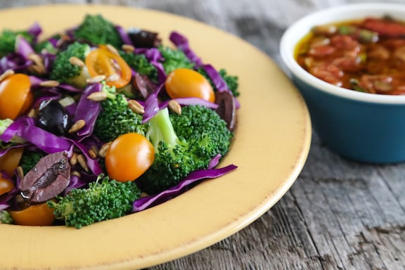 Broccoli and red cabbage salad with tomatoes