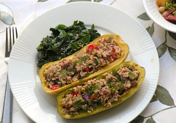 Rice-stuffed squashes served with steamed greens