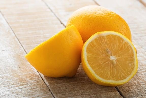 Fresh lemons on table