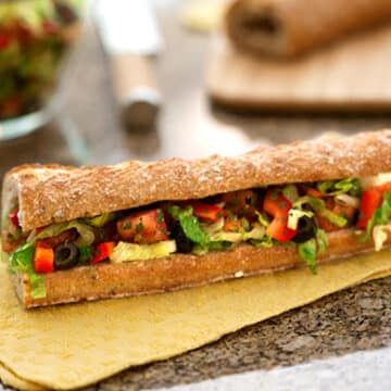Mediterranean salad-stuffed bread (pan bagnat)