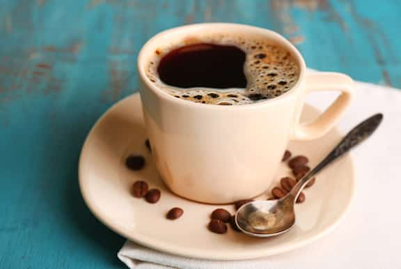 Cup of coffee with fresh coffee beans