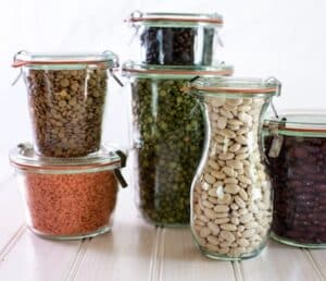 Jars with legumes cropped