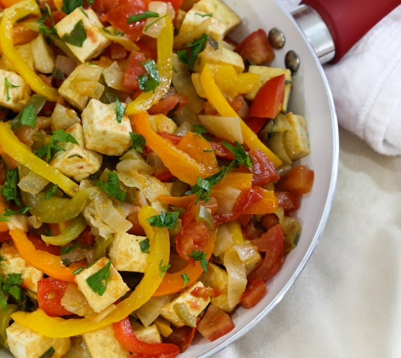 Summer tofu skillet with tomatoes and bell peppers recipe