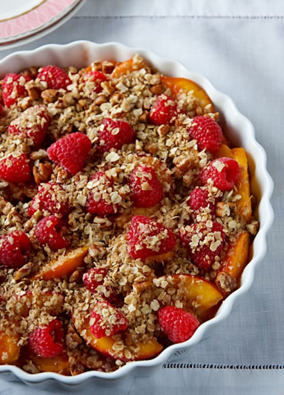 Unbaked vegan peach and raspberry crumble