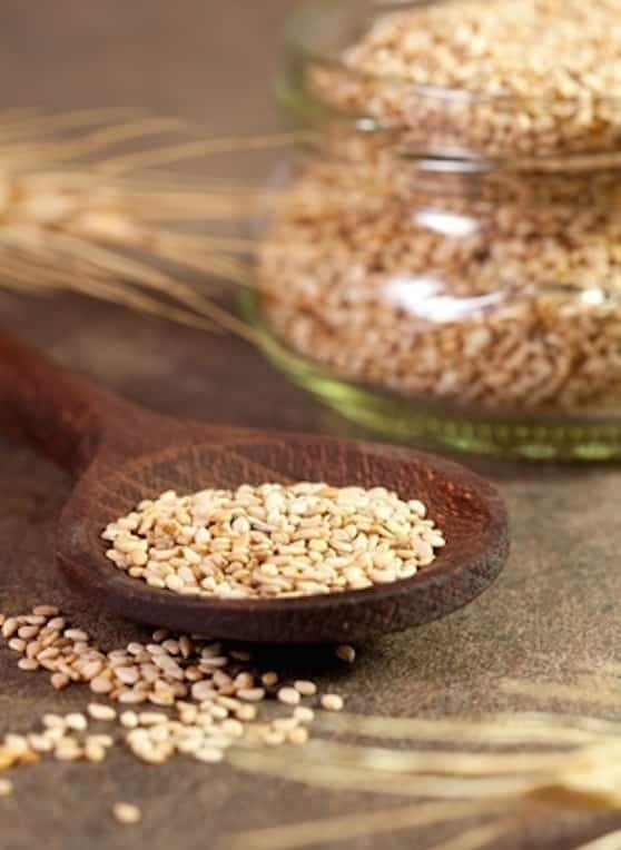Unhulled sesame seeds in a spoon