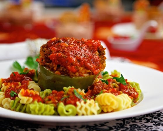 Stuffed green bell peppers by Laura Theodore