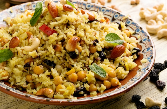 Brown rice pilaf with dried fruits, nuts, and chickpeas
