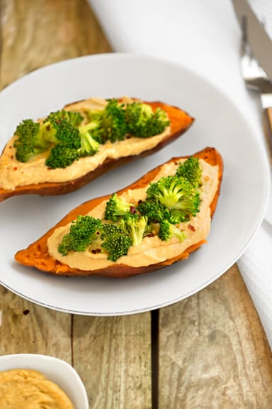 Hummus and broccoli stuffed sweet potatoes