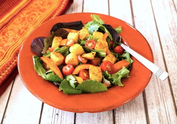 Tube Polenta croutons on salad