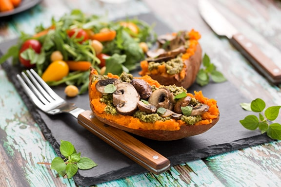 Pesto and Mushroom-Stuffed sweet potato dinner