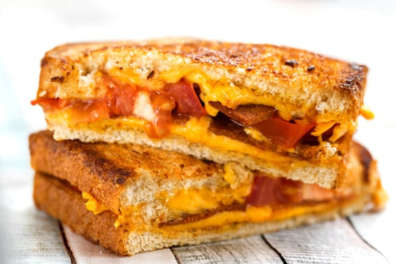 Vegan grilled cheese sandwich stack with tomato & vegan bacon