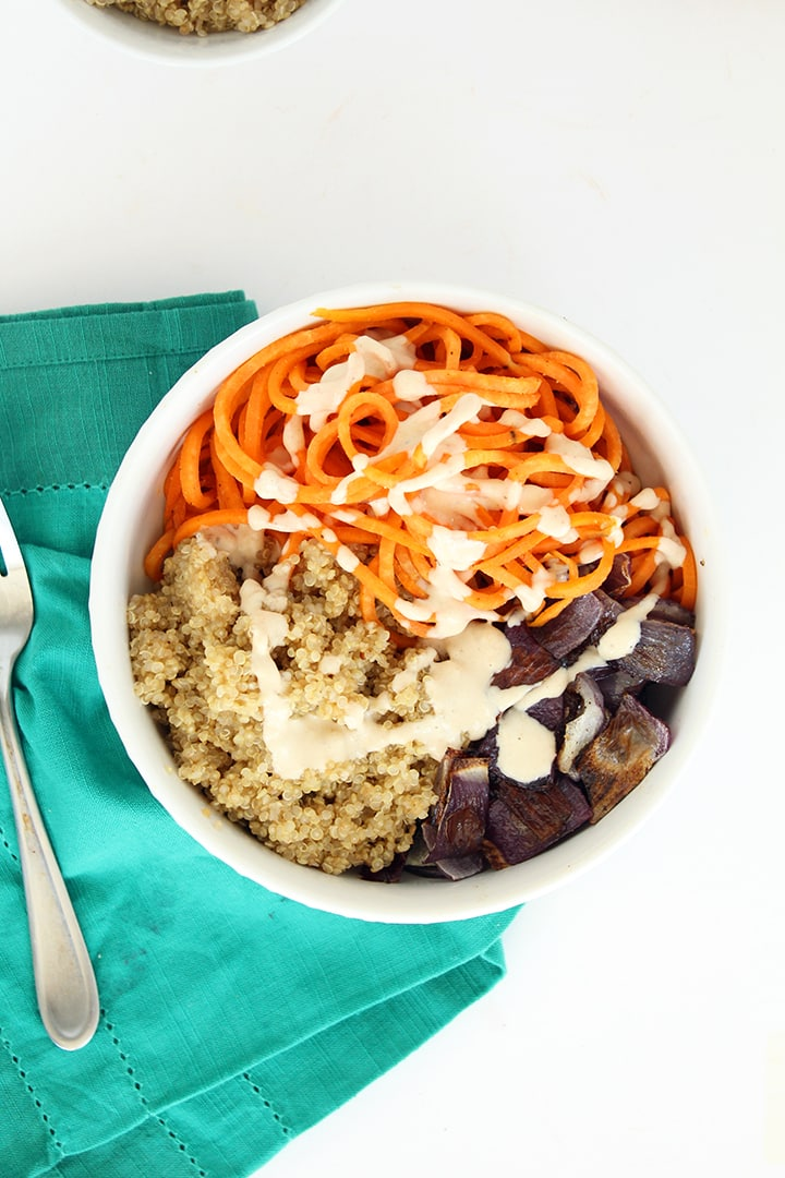 sweet potato roasted onion and quinoa bowl with maple tahini dressing