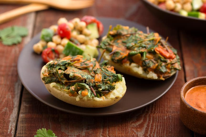 Greens-stuffed curried potato dinne