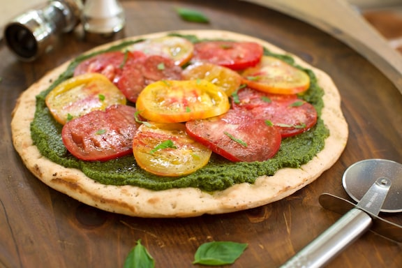 pesto pizza with heirloom tomatoes