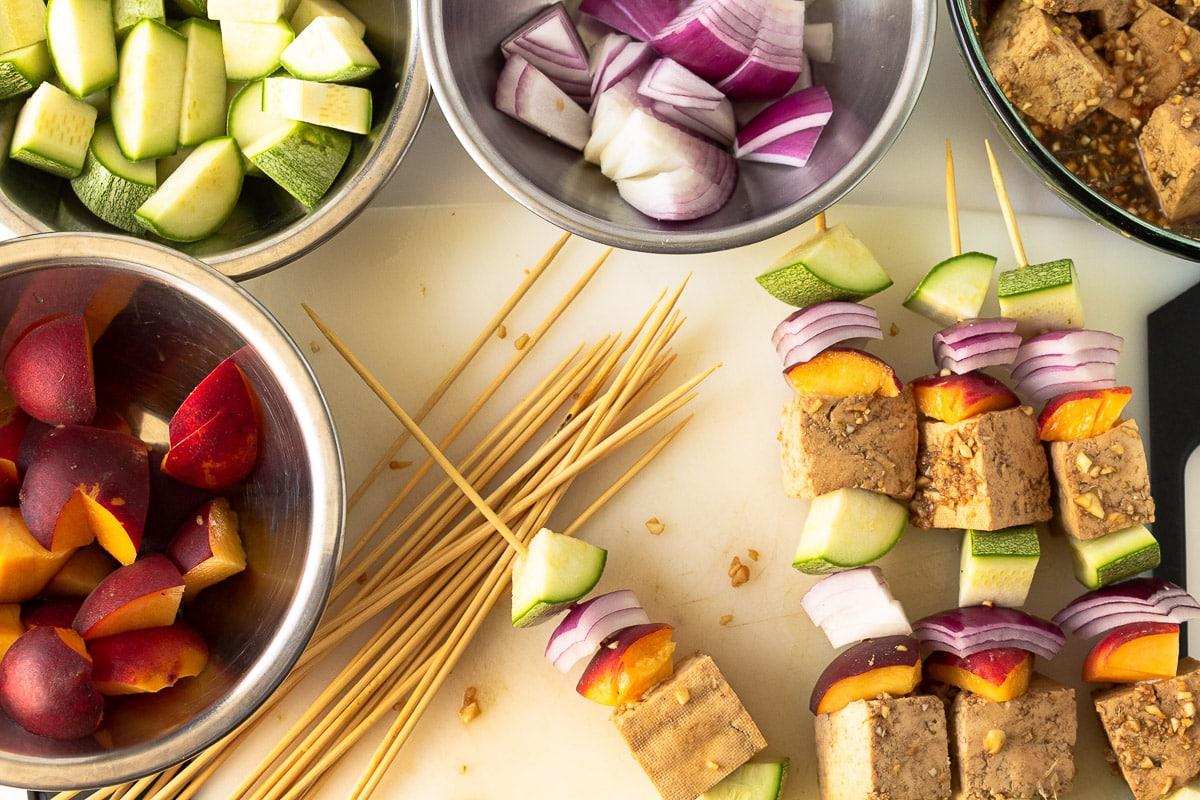 tofu kebabs in progress of being skewered