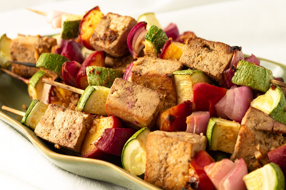 plate of stacked grilled tofu skewers
