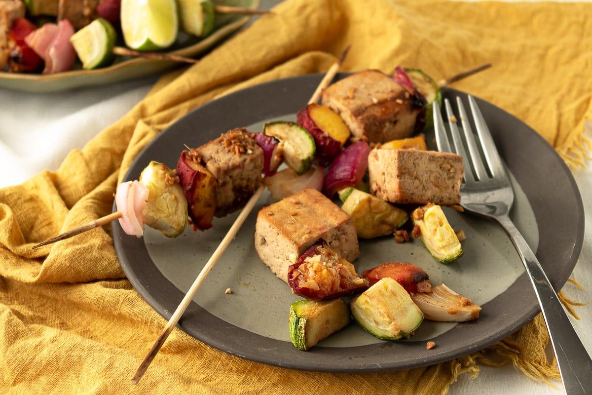 plate of one kebab and one unskewered kebab