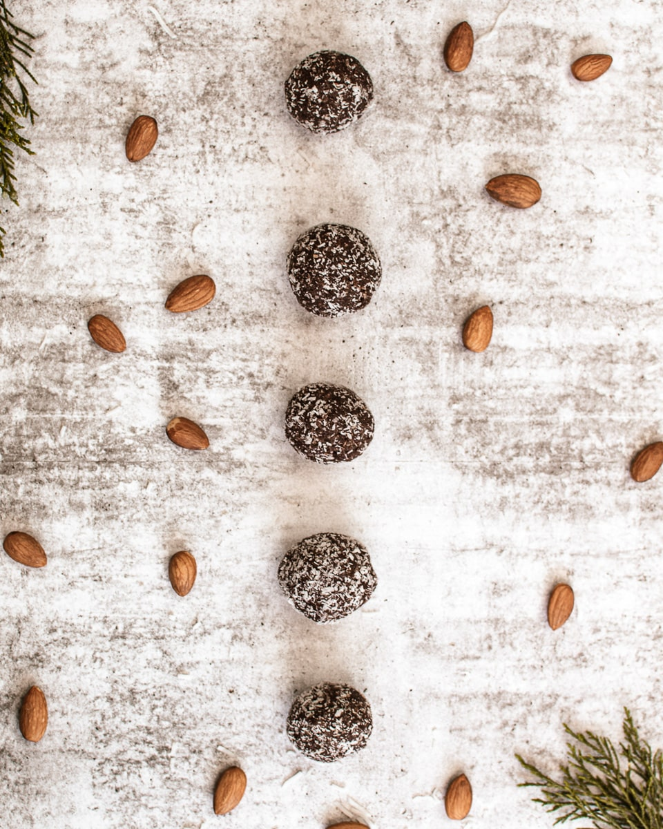 row of almond butter protein balls on counter