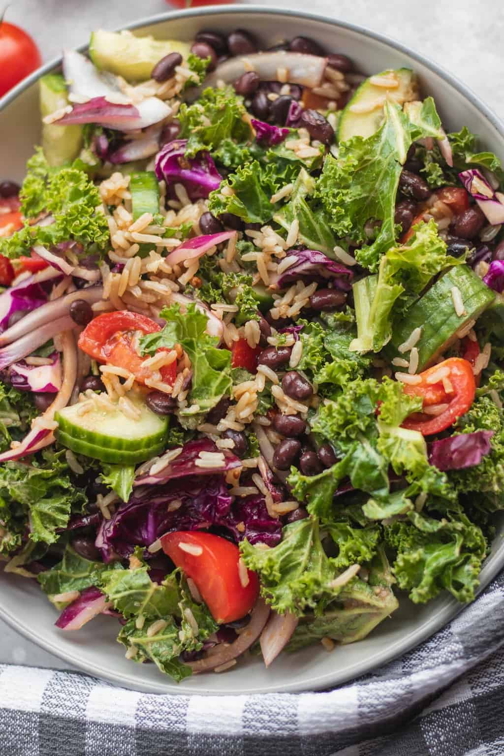 kale salad being served with a checkered cloth