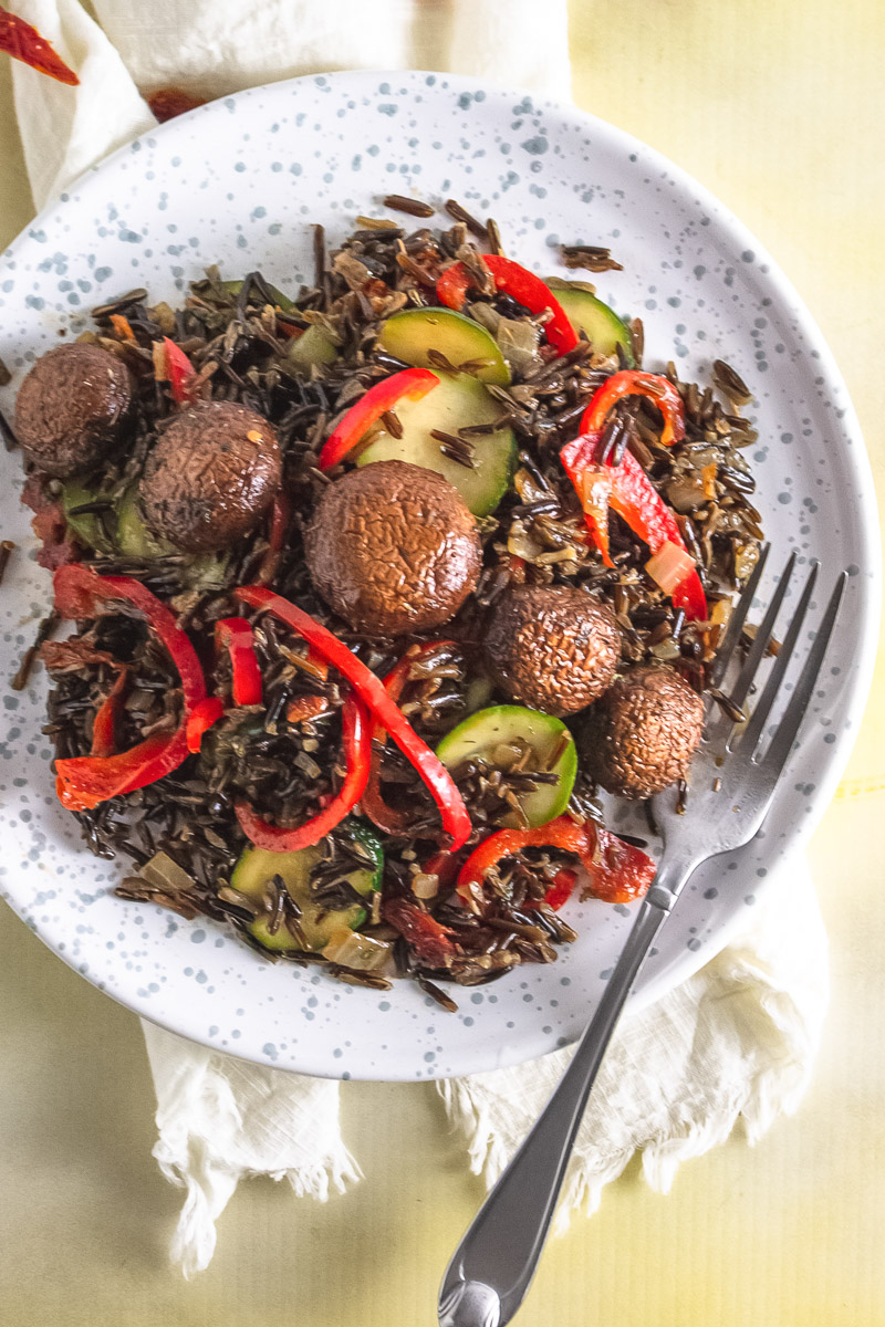 plate of wild rice with marinated mushrooms